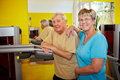 Elderly couple in gym Royalty Free Stock Photo