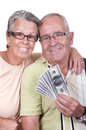 Elderly couple holding bills happy Royalty Free Stock Photography