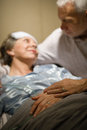 Elderly couple holding hands at clinic ward Royalty Free Stock Photo