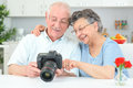 Elderly couple looking at pictures