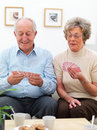 Elderly couple playing a game of cards Royalty Free Stock Images