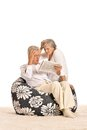 Elderly couple reading Royalty Free Stock Photo