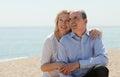 Elderly couple at sea shore senior mature in love in warm season Stock Images