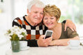 Elderly couple smart phone lovely using at home Royalty Free Stock Image