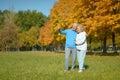 Elderly couple smiling together over natural background Stock Image