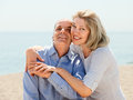 Elderly couple spends time on seaside at sunny day Royalty Free Stock Photography