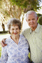 Elderly Couple Standing in Yard Royalty Free Stock Photography