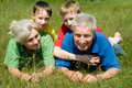 Elderly couple with their grandchildren Stock Images