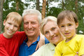 Elderly couple with their grandchildren Royalty Free Stock Photos