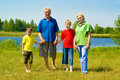Elderly couple with their grandchildren playing so Royalty Free Stock Photo