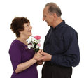 Elderly couple together an with flowers isolated on white Stock Photos