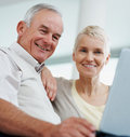 Elderly couple using a laptop together Stock Image