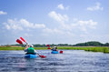 Elderly couples kayaking on river Royalty Free Stock Photo
