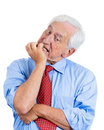 Elderly desperate mad crazy looking man biting his nails a close up portrait of an isolated on white background with copy space Stock Image