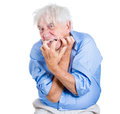 Elderly desperate mad crazy looking man biting his nails a close up portrait of an isolated on a white background extremes of Stock Photography