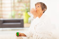 Elderly drinking medicine Stock Photo