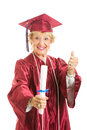 Elderly graduate gives thumbs up happy senior lady graduates in her cap and gown giving Royalty Free Stock Images
