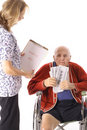 Elderly handicap senior paying medical bill Royalty Free Stock Photography
