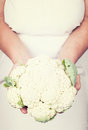 Elderly hands holding fresh califlower with vintage styl organic style Stock Images
