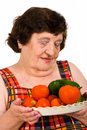 Elderly  holding  tomatoes and cucumbers Stock Photo