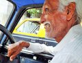 Elderly indian taxi driver in mumbai india proud Royalty Free Stock Photo