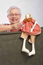 Elderly lady playing puppet show Stock Images