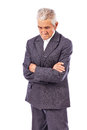 Elderly man with arms folded looking down lost in deep thought on white background Stock Photos