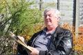 Elderly man with bad eyesight squinting. Royalty Free Stock Photo