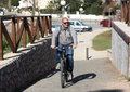 Elderly man on a bicycle an in sportswear bike rides Royalty Free Stock Photo