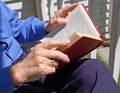 Elderly man with book Stock Images