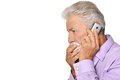 Elderly man calling to the doctor close up portrait of an Stock Photography
