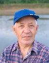 Elderly man in cap Royalty Free Stock Photo