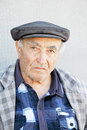 Elderly man in checkered jacket and cap Royalty Free Stock Photo