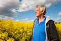 Elderly man in coleseed Royalty Free Stock Photo