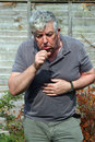 Elderly Man Coughing. Smoking.