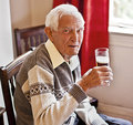 Elderly man with a drink