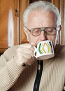 Elderly man drinks tea Royalty Free Stock Photo