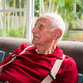Elderly man eighty plus year old in a home setting Stock Photos