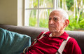 Elderly man eighty plus year old in a home setting Royalty Free Stock Images