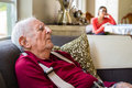 Elderly man eighty plus year old men asleep in a home setting Stock Photography