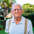 Elderly man eighty plus year old outdoors in a home setting Stock Photos