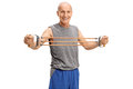 Elderly man exercising with a resistance band studio shot of an isolated on white background Stock Images
