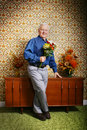 Elderly man with flowers Royalty Free Stock Photography