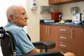 Elderly man handicapped plus year old in a doctor office setting Royalty Free Stock Photos