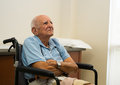 Elderly man handicapped plus year old in a doctor office setting Stock Photo