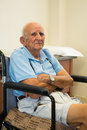 Elderly man handicapped plus year old in a doctor office setting Royalty Free Stock Photo