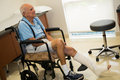 Elderly man handicapped plus year old in a doctor office setting Stock Images