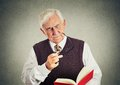 Elderly man holding book, glasses having eyesight problems Royalty Free Stock Photo