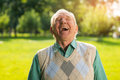 Elderly man laughing senior male on nature background wonderful mood every day can t restrain the laughter Stock Photography