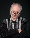 Elderly man looks skeptical   Royalty Free Stock Photos